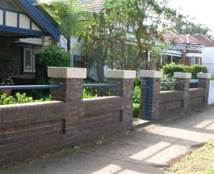 Masonry pier and panel fences